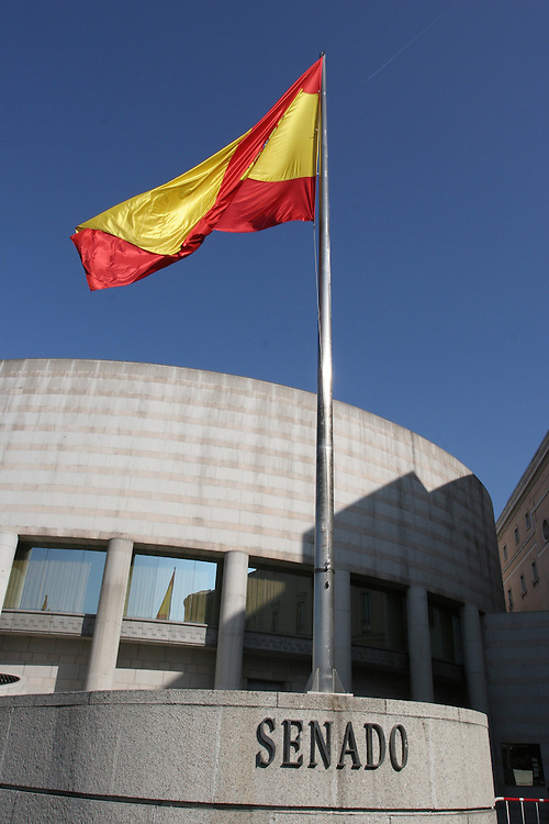 Spanish Senate, with the Spanish flag waving in the wind, in Madrid.