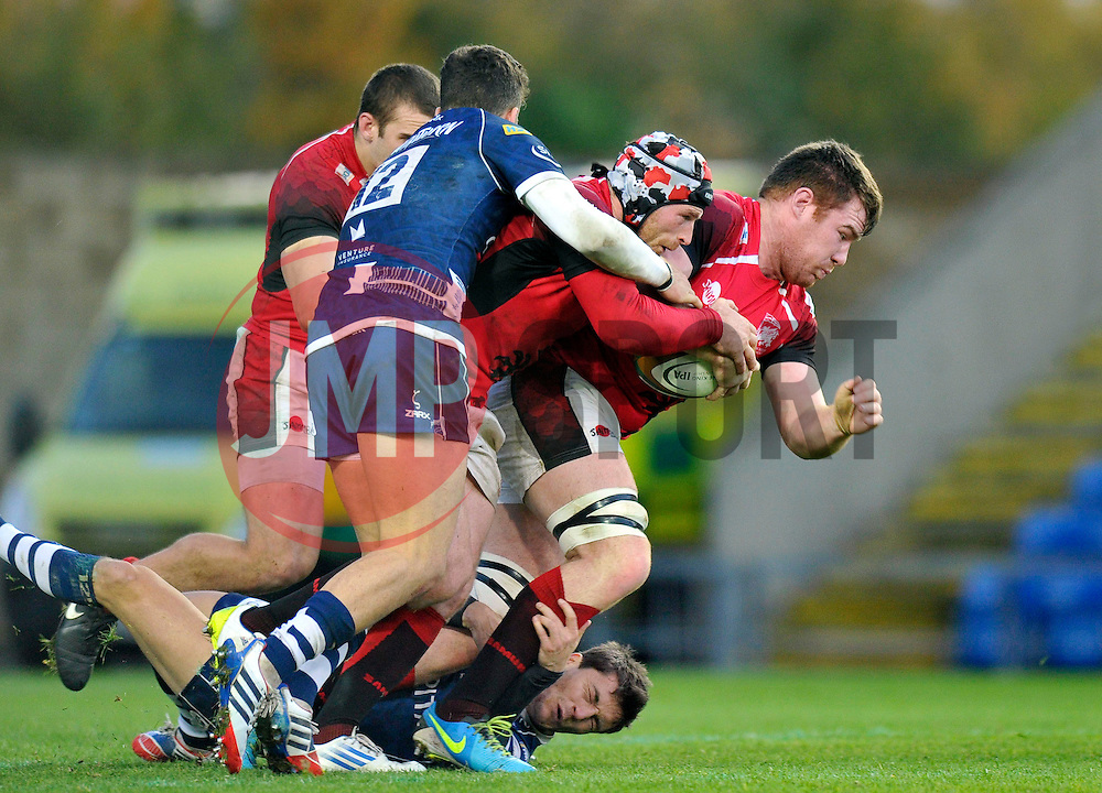 Ollie Stedman (London Welsh) is tackled in possession - Photo mandatory by-line: Patrick Khachfe/JMP - Tel: 07966 386802 - 10/11/2013 - SPORT - RUGBY UNION - Kassam Stadium, Oxford - London Welsh v Bristol Rugby - Greene King IPA Championship.