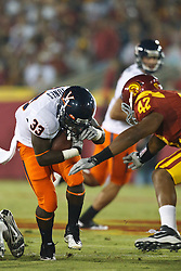 September 11, 2010; Los Angeles, CA, USA;  Virginia Cavaliers running back Perry Jones (33) is tackled by Southern California Trojans linebacker Devon Kennard (42) during the first quarter at the Los Angeles Memorial Coliseum.