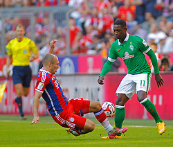 MUNICH, GERMANY - OCTOBER 18: Arjen Robben of Bayern Munich and Eljero Elia of Werder Bremen compete for the ball during the Bundesliga match between Bayern Munich and Werder Bremen. October 18, 2014 in Munich, Germany. Photo mandatory by-line: Mitchell Gunn