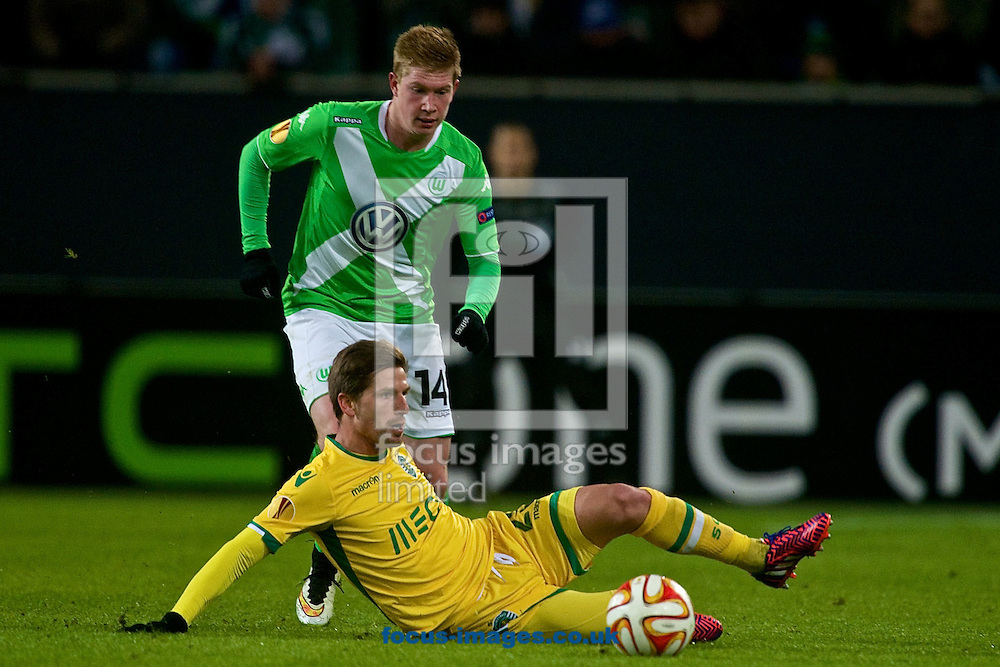 Adrien Silva of Sporting Clube de Portugal tackles Kevin De Bruyne of VfL Wolfsburg during the UEFA Europa League match at Volkswagen Arena, Wolfsburg<br /> Picture by Ian Wadkins/Focus Images Ltd +44 7877 568959<br /> 19/02/2015