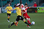 Stuart Lewis of Ebbsfleet battles with \Whitehawk striker Jake Robinson during the National League South Play Off 1st Leg match between Whitehawk FC and Ebbsfleet United at the Enclosed Ground, Whitehawk, United Kingdom on 4 May 2016. Photo by Phil Duncan.