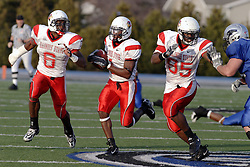 25 November 2006: Jesse Caesar gets protection from Kye Stewart and Ronnie Tate after intercepting a Panther pass late in the 4th quarter.&#xD;The Redbirds romped the Panthers by a score of 24-13.&#xD;This game was a 1st round NCAA Division 1 Playoff held at O'Brien Stadium on the campus of Eastern Illinois University in Charleston Illinois.<br />