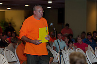 Neil Irvine chair of the Board of Selectmen of New Hampton speaks at the podium during the Northern Pass public session at Opechee Conference Center Thursday evening.  (Karen Bobotas/for the Laconia Daily Sun)