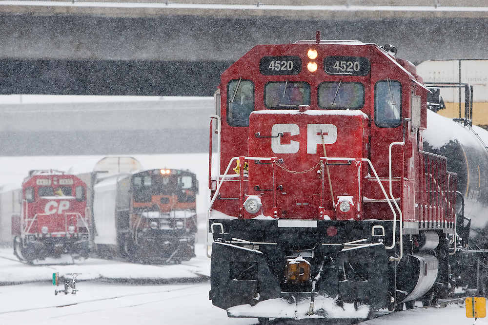 During a heavy snowstorm, a Canadian Pacific Railway freight train departs the yard in Franklin Park, IL.