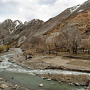 Small villages and hamlets are dotted along the main road from Maza-i-Sharif to Kabul as the route passes through the Hindu Kush mountains and the valley's below. Mazar to Kabul road, Afghanistan on the 12th of April 2009.