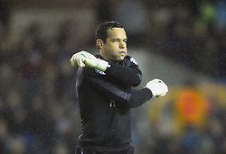Millwall's David Forde keeps warm on a cold wet night at The Den - Photo mandatory by-line: Robin White/JMP - Tel: Mobile: 07966 386802 21/12/2013 - SPORT - FOOTBALL - The Den - Millwall - Millwall v Middlesbrough - Sky Bet Championship