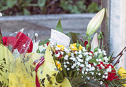 © Licensed to London News Pictures. 03/02/2016. Allerton Bywater UK. Picture shows a note with the names Gerry, Shannon & Shane left on flowers at a scene on Beeston way were a police investigation is still underway after the bodies of two children & a woman were found at the property. Photo credit: Andrew McCaren/LNP