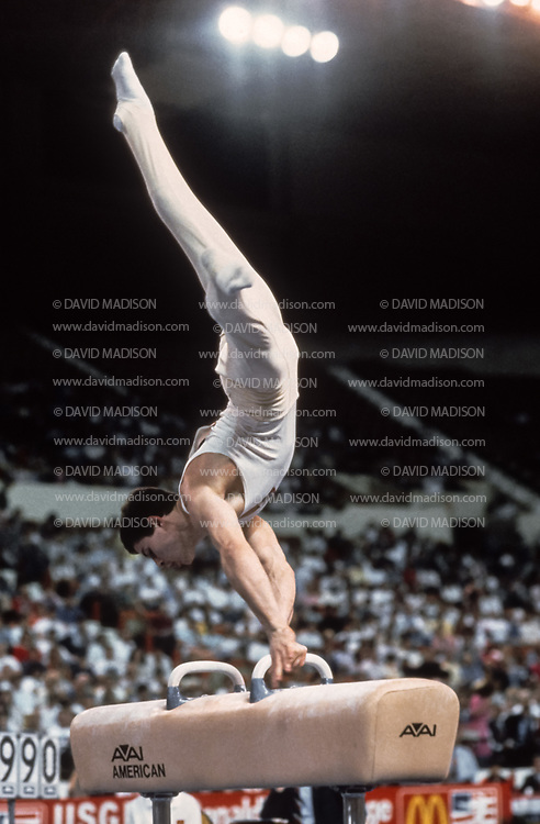 PHOENIX - APRIL 24:  Dimitri Belozerchev of the USSR competes on the pommel horse during a USA - USSR gymnastics meet on April 24, 1988  at the Arizona Veterans Memorial Coliseum in Phoenix, Arizona.  (Photo by David Madison/Getty Images)