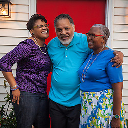 """Carlos and Debbie Allen with daughter Deidre celebrate their marriage of 37 years and their move to Eastgate 30 years ago. Carlos is retired due to a tragic car accident that left him disabled 19 years ago. A drunk driver struck Carlos on his way home from work, which resulted in 6 months of intense rehabilitation. """"Though he currently still suffers from short-term memory loss, we are blessed with his presence,"""" says Debbie. He enjoys reading the Dispatch newspaper everyday including sports news."""