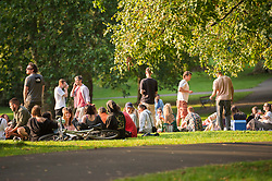 © Licensed to London News Pictures; 12/09/2020; Bristol, UK. Large groups of young people enjoy the early evening sunshine in St Andrews Park, on the last weekend before new restrictions for the coronavirus covid-19 pandemic come into law in England. From Monday 14 September it will be illegal to meet up in groups of more than six people, known as the rule of six, in order to try and contain the spread of the coronavirus. Yesterday Bristol recorded the biggest daily increase in 10 weeks of new cases of coronavirus, and nationally, 3,539 new cases have been confirmed, the highest rise for four months. Photo credit: Simon Chapman/LNP.