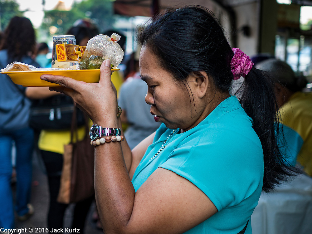 04 JANUARY 2016 - BANGKOK, THAILAND:        A woman prays in Bang Chak Market on the last day it was open. The market closed January 4, 2016. The Bang Chak Market serves the community around Sois 91-97 on Sukhumvit Road in the Bangkok suburbs. About half of the market has been torn down. Bangkok city authorities put up notices in late November that the market would be closed by January 1, 2016 and redevelopment would start shortly after that. Market vendors said condominiums are being built on the land.     PHOTO BY JACK KURTZ