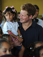 Prince Harry visits the Complexo do Alem&atilde;o and meets a youth choir, Rio de Janeiro, Brazil, on the 10th March 2012.<br /> PICTURE BY JAMES WHATLING