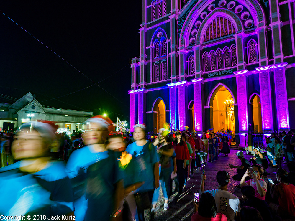 "23 DECEMBER 2018 - CHANTABURI, THAILAND: The Christmas procession at the Cathedral of the Immaculate Conception's Christmas Fair in Chantaburi. Cathedral of the Immaculate Conception is holding its annual Christmas festival, this year called ""Sweet Christmas @ Chantaburi 2018"". The Cathedral is the largest Catholic church in Thailand and was founded more than 300 years ago by Vietnamese Catholics who settled in Thailand, then Siam.   PHOTO BY JACK KURTZ"