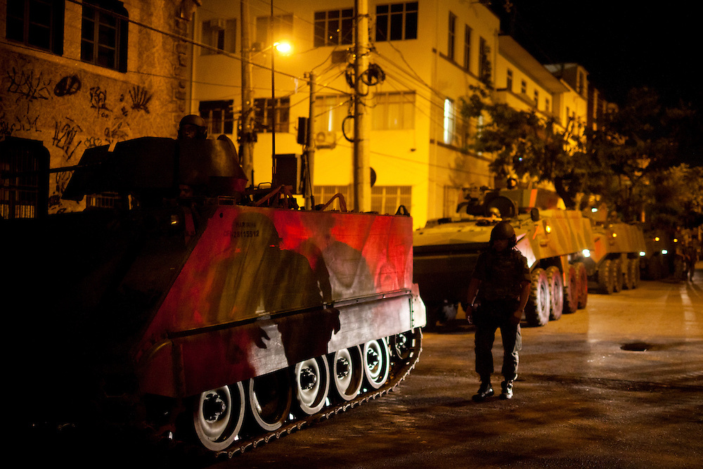 Brazilian Navy soldiers prepare armored vehicles during a joint public security operation to install a Pacifying Police Unit (UPP) at the Caju favela complex in Rio de Janeiro, Brazil, Sunday, March 3, 2013. Elite police units backed by armored military vehicles and helicopters invaded the neighborhood of 13 communities in Caju favela complex early Sunday in an on-going policing program aimed to drive violent and heavily armed drug gangs out of Rio's poor communities, where the traffickers have ruled for decades.