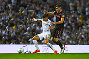 Leeds United defender Gaetano Berardi (28) and Stoke City forward Sam Vokes (9) in action during the EFL Cup match between Leeds United and Stoke City at Elland Road, Leeds, England on 27 August 2019.