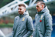 Leeds United defender Stuart Dallas (15) and Leeds United defender Barry Douglas (3) arrives at the ground during the EFL Sky Bet Championship match between Huddersfield Town and Leeds United at the John Smiths Stadium, Huddersfield, England on 7 December 2019.