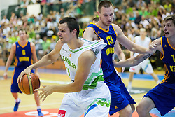 Jure Balazic of Slovenia vs Igor Zaytsev of Ukraine during friendly basketball match between National teams of Slovenia and Ukraine at day 3 of Adecco Cup 2014, on July 26, 2014 in Rogaska Slatina, Slovenia. Photo by Vid Ponikvar / Sportida.com