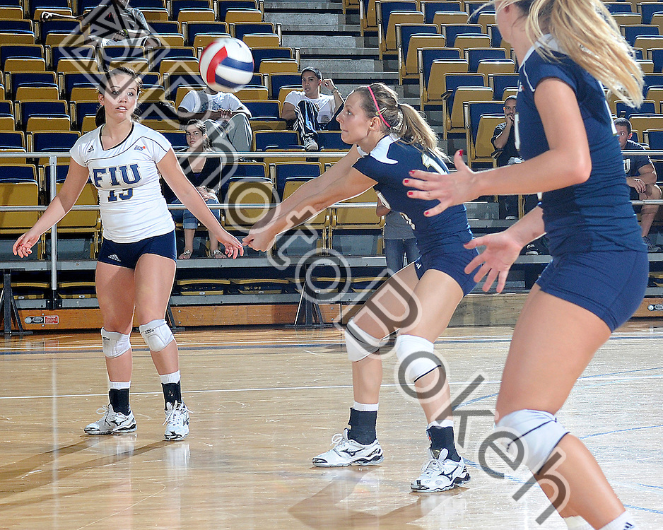 2011 October 28 - FIU's Marija Prsa (10) returning a volley. Florida International University Golden Panthers defeated the Troy Trojans, 3-1, at U.S. Century Bank Arena, Miami, Florida. (Photo by: www.photobokeh.com / Alex J. Hernandez) 1/250 f/7.1 ISO400 82mm