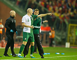 BRUSSELS, BELGIUM - Tuesday, October 15, 2013: Wales' James Collins uses green tape during the 2014 FIFA World Cup Brazil Qualifying Group A match against Belgium at the Koning Boudewijnstadion. (Pic by David Rawcliffe/Propaganda)