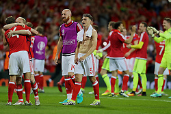 TOULOUSE, FRANCE - Monday, June 20, 2016: Wales' Ben Davies, Jonathan Williams, James Collins and James Chester celebrate the 3-0 victory over Russia and reaching the knock-out stage during the final Group B UEFA Euro 2016 Championship match at Stadium de Toulouse. (Pic by David Rawcliffe/Propaganda)