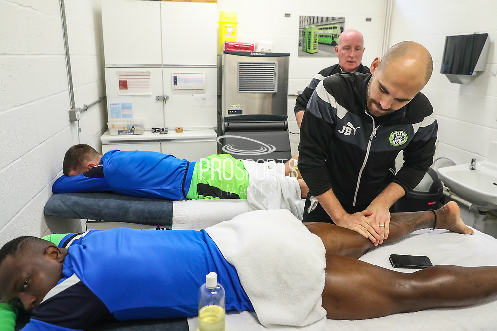 Forest Green Rovers Drissa Traoré(4) recieving a pre match massage from Forest Green Rovers physio Joe Baker during the EFL Sky Bet League 2 match between Forest Green Rovers and Cheltenham Town at the New Lawn, Forest Green, United Kingdom on 25 November 2017. Photo by Shane Healey.