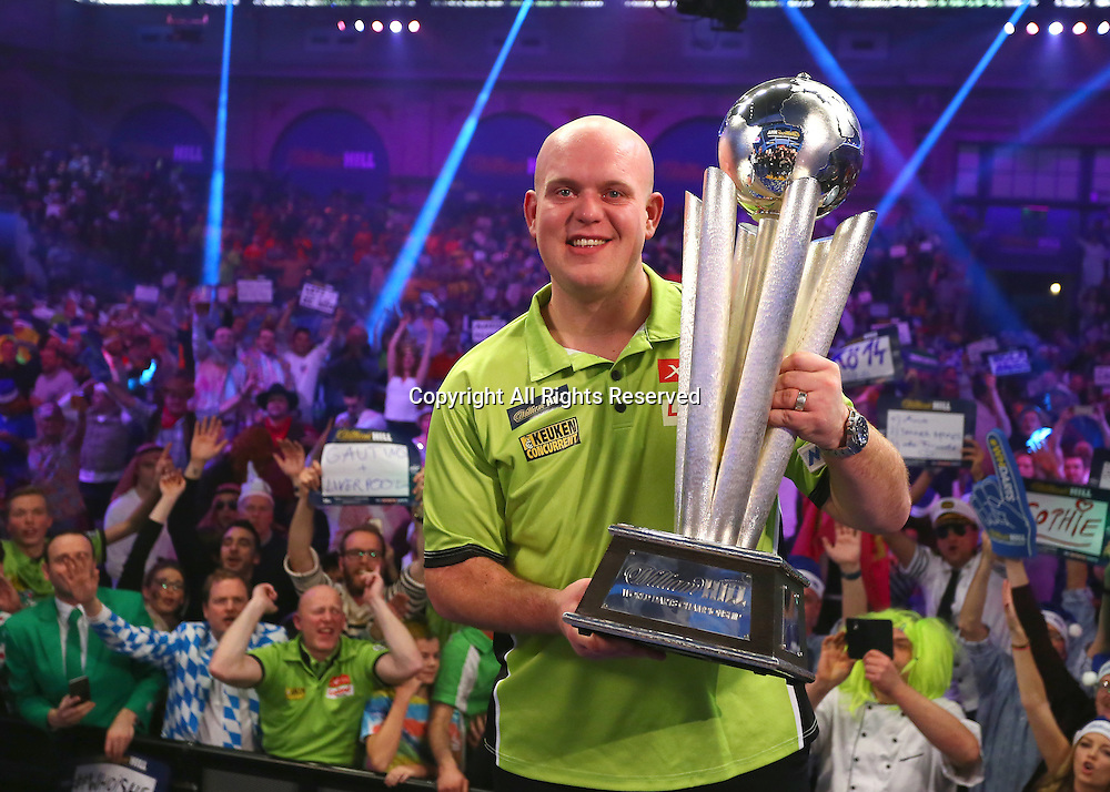 02.01.2017. Alexandra Palace, London, England. William Hill PDC World Darts Championship final  between top seeds Michael van Gerwen (1) and Gary Anderson (2). Michael van Gerwen celebrates winning the World Darts Final and poses with the Trophy on the Oche, after beating Defending World Champion Gary Anderson 7 sets to 3