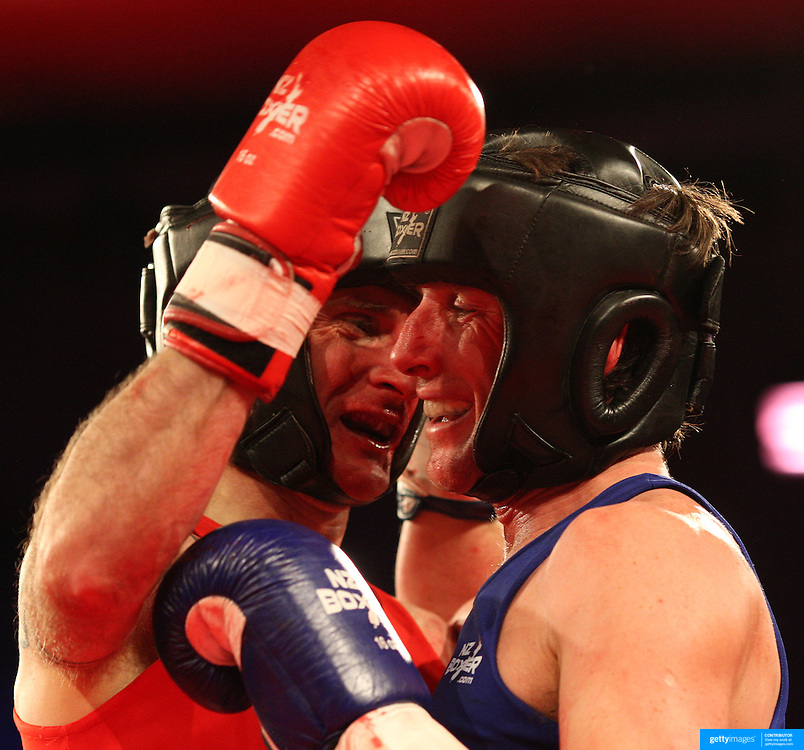 Brett Black (red) and Dave Hertog (blue) during their bout at the 'Thriller in the Chiller' charity boxing event as part of the Queenstown Winter Festival at the Queenstown Events Centre , South Island, New Zealand, 25th June 2011