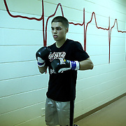 "Luis Olivares gets ready in the locker area during the ""Boxeo Telemundo"" boxing match at the Kissimmee Civic Center on Friday, March 14, 2014 in Kissimmme, Florida. (Photo/Alex Menendez)"