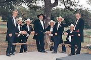Groom and his groomsmen, outdoors.