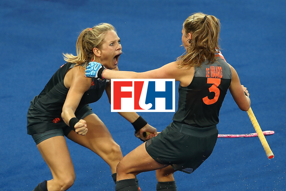 RIO DE JANEIRO, BRAZIL - AUGUST 19:  Kitty van Male of the Netherlands (L) celebrates scoring a goal with Xan de Waard during the Women's Gold Medal Match against Great Britain on Day 14 of the Rio 2016 Olympic Games at the Olympic Hockey Centre on August 19, 2016 in Rio de Janeiro, Brazil.  (Photo by Mark Kolbe/Getty Images)