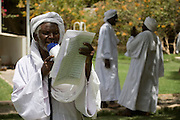 A traditional story-teller delivers his tales from Islamic texts during the first-ever international Conference on Womens' Challenge in Darfur, arranged in a compound belonging to the Govenor of North Darfur in Al Fasher (also spelled, Al-Fashir) where the women from remote parts of Sudan gathered to discuss peace and political issues.