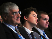 © Licensed to London News Pictures. 05/10/2011. MANCHESTER. UK. A young delegate listens to Liam Fox's speech at The Conservative Party Conference at Manchester Central today, October 5, 2011. Photo credit:  Stephen Simpson/LNP