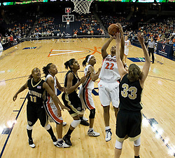 UVA's Monica Wright (22) shoots in the paint over Wake Forest's Corinne Groves (33).  The Cavaliers defeated the Demon Deacon 77-71 on January 11, 2007 for their first ACC win in the John Paul Jones Arena in Charlottesville, VA.<br />