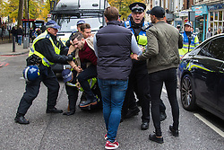 London, November 6th 2016. Police tackle a man following a scuffle after the North London Derby between Arsenal FC and Tottenham Hotspur, that ended in a 1-1 draw.