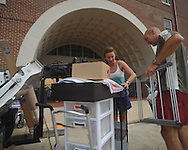 Meredith Oliver (left), with help from her father Gordon, begins moving into a dorm at the University of Mississippi in Oxford, Miss. on Wednesday, August 17, 2011. Classes for the fall semester begin Monday, August 22, 2011.