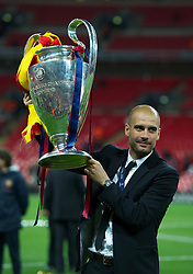 28.05.2011, Wembley Stadium, London, ENG, UEFA CHAMPIONSLEAGUE FINALE 2011, FC Barcelona (ESP) vs Manchester United (ENG), im Bild FC Barcelona's head coach Josep Guardiola celebrates with the European Cup trophy after thrashing Manchester United 3-1 during the UEFA Champions League Final at Wembley Stadium, EXPA Pictures © 2011, PhotoCredit: EXPA/ Propaganda/ Chris Brunskill *** ATTENTION *** UK OUT!