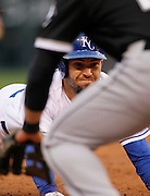 Kansas City Royals' Eric Hosmer slides into third base after hitting a triple in the third inning of a baseball game against the Chicago White Sox at Kauffman Stadium in Kansas City, Mo., Saturday, May 4, 2013.  (AP Photo/Colin E. Braley).