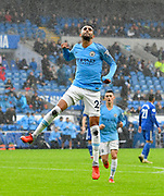 Goal - Riyad Mahrez (26) of Manchester City celebrates scoring a goal to give a 0-5 lead to the away team during the Premier League match between Cardiff City and Manchester City at the Cardiff City Stadium, Cardiff, Wales on 22 September 2018.