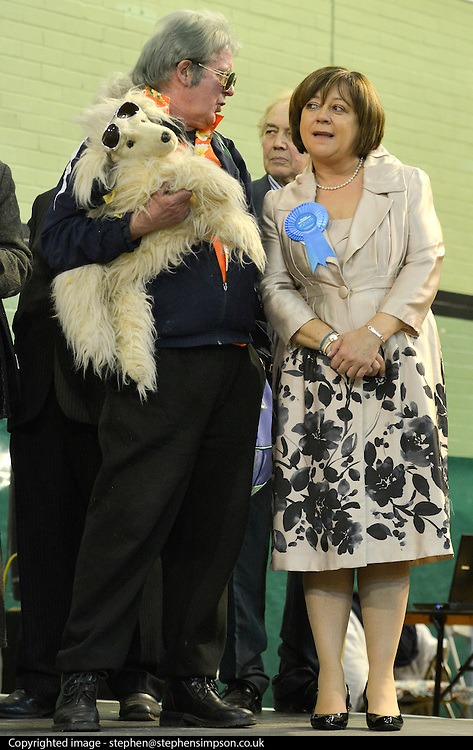 © Licensed to London News Pictures. 01/03/2013. Eastleigh, UK (L) DAVID BISHOP - Elvis Loves Pets Party talks with MARIA HUTCHINGS - Conservative. Ballot boxes begin to arrive at the count centre at  Fleming Park Leisure Centre in Eastleigh this evening. The voters of Eastleigh vote to choose a new MP in a by-election prompted by the resignation of former Lib Dem cabinet minister Chris Huhne. Polling will continued 22:00 GMT 28/02/13, with votes counted overnight on Thursday. There are 14 candidates in total on the ballot papers.. Photo credit : Stephen Simpson/LNP