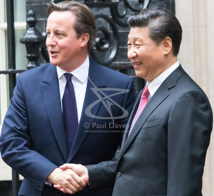 Chinese President Xi Jinpeng Greeted by David Cameron at