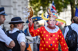 © Licensed to London News Pictures. 29/08/2019. LONDON, UK.  An anti-Brexit campaigner dressed as Boris Johnson as a clovn protests outside Cabinet Office.  The protest takes place the day after Boris Johnson, Britain's Prime Minister, announced the intention to suspend Parliament, under the mechanism of prorogation, in order to refine his Brexit plans.  Photo credit: Stephen Chung/LNP