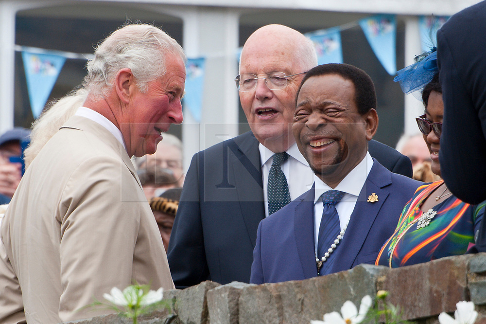 © Licensed to London News Pictures. 22/07/2019. Llanelwedd, Powys, UK. Prince Charles is introduced to King Goodwill Zwelithini kaBhekuzulu (King of the Zulus)  HRH Prince Charles, Prince of Wales, and Her Royal Highness, Camilla Parker Bowles, The Duchess of Cornwall visit the Royal Welsh Agricultural Show on the first day of the 100th Royal Welsh Agricultural Show. The Royal Welsh Agricultural Show is hailed as the largest & most prestigious event of its kind in Europe. In excess of 200,000 visitors are usually expected for the annual four day show period. The Royal Welsh Agricultural Society was founded in 1904. Photo credit: Graham M. Lawrence/LNP