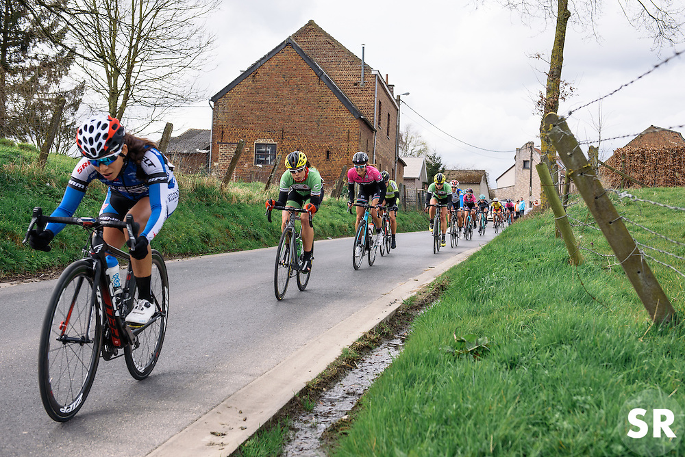 Peloton speed back to Gooik for with a little over one lap to go - Pajot Hills Classic 2016, a 122km road race starting and finishing in Gooik, on March 30th, 2016 in Vlaams Brabant, Belgium.