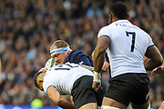 W P Nel is tackled by Jale Vatabua during the 2018 Autumn Test match between Scotland and Fiji at Murrayfield, Edinburgh, Scotland on 10 November 2018.