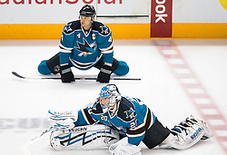 April 16, 2010; San Jose, CA, USA; San Jose Sharks goaltender Evgeni Nabokov (20) and defenseman Rob Blake (4) stretch before game two in the first round of the 2010 Stanley Cup Playoffs against the Colorado Avalanche at HP Pavilion.  The Sharks defeated the Avalanche 6-5 in overtime. Mandatory Credit: Jason O. Watson / US PRESSWIRE