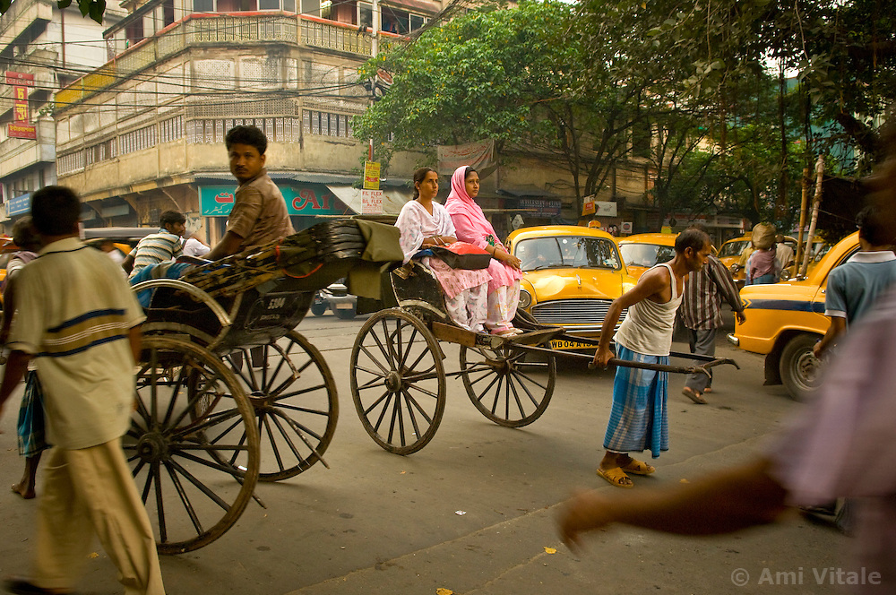Rickshaw pullers work in Southern Calcutta, September 12, 2007.   This congested city was the first city of the colonial British and  now it is the only city of India where hand pulled rickshaws are still being pulled. In 1996, the Government of West Bengal announced that it was intending to ban the rickshaws to relieve traffic congestion  but it never was fully enforced. In 2007, the government again pushed to have the ban enforced and a case is currently being decided in the Supreme court that will determine the outcome for the hand pulled rickshaws.