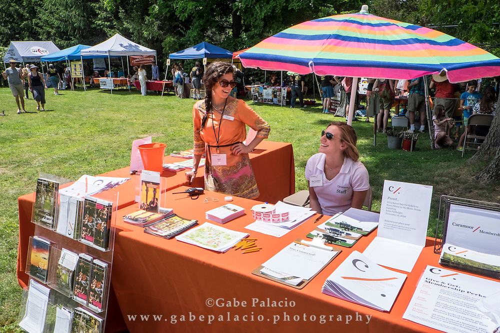 Caramoors info table by the Cultural Partners at the American Roots Music Festival at Caramoor in Katonah New York on June 28, 2014. <br /> (photo by Gabe Palacio)
