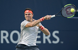 TORONTO, Aug. 7, 2018  Milos Raonic of Canada hits a return during the first round of men's singles match against David Goffin of Belgium at the 2018 Rogers Cup in Toronto, Canada, Aug. 6, 2018. Milos Raonic won 2-0. (Credit Image: © Xinhua via ZUMA Wire)