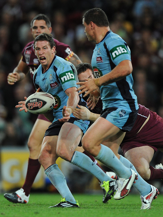 July 6th 2011: Kurt Gidley of the Blues passes the ball in the tackle during game 3 of the 2011 State of Origin series at Suncorp Stadium in Brisbane, QLD, Australia on July 6, 2011. Photo by Matt Roberts / mattrimages.com.au / QRL